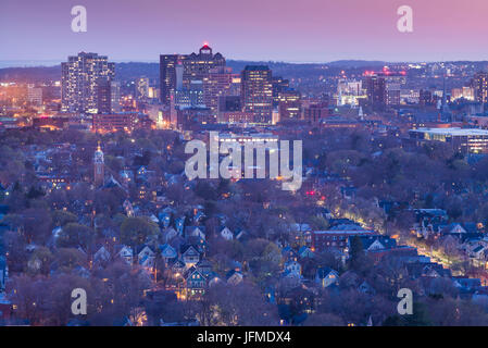 USA, Connecticut, New Haven, city skyline from East Rock Park, dusk - Stock Photo