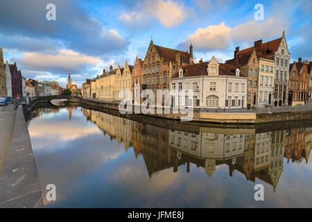 Pink clouds at dawn on the Belfry and historic buildings reflected in the typical canal Bruges West Flanders Belgium - Stock Photo