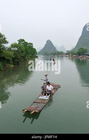 China, Guangxi Province, Guilin Region, Karst Mountain Landscape and Yulong River around Yangshuo, Chinese tourist - Stock Photo