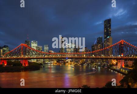Story Bridge lit up after dark, Brisbane, Australia - Stock Photo