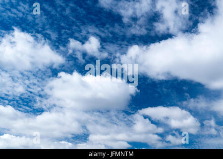 White clouds under a classic blue sky in Northern England - Stock Photo