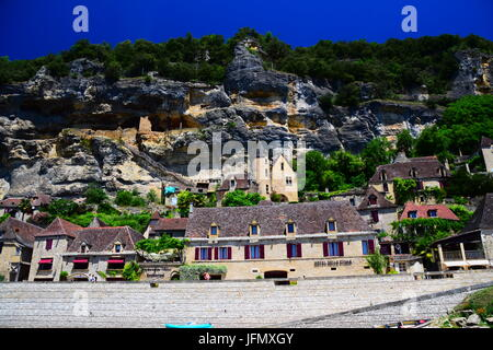 The magical village of La Roque Gageac on the banks of the Dordogne River in southwest France - Stock Photo