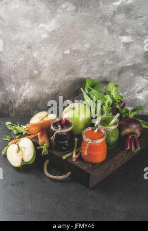 Vegan diet food. Detox drinks. Freshly squeezed juices and smoothies from vegetables: beets, carrots, spinach, cucumber, - Stock Photo