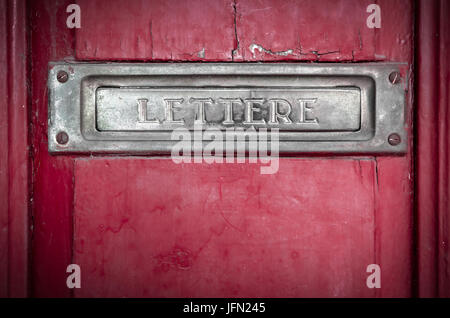 Letter box in a red door - Stock Photo