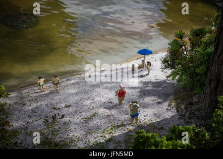 Billund, Denmark - July 27, 2017:  Lego bricks people on the beach preparing to swim, the scene made out of the - Stock Photo