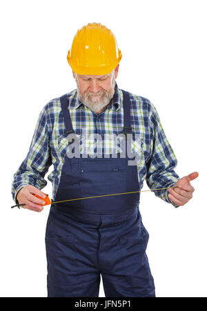 Picture of an elderly builder with construction instruments in his hands posing on isolated background - Stock Photo