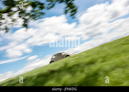 VW Beetle - Classic Car on the Road - Stock Photo