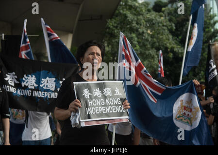 Hong Kong. 01st July, 2017. Pro-independence activist chant slogan during a demonstration in Hong Kong. Thousands - Stock Photo