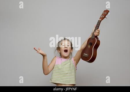 girl with ukulele guitar - Stock Photo