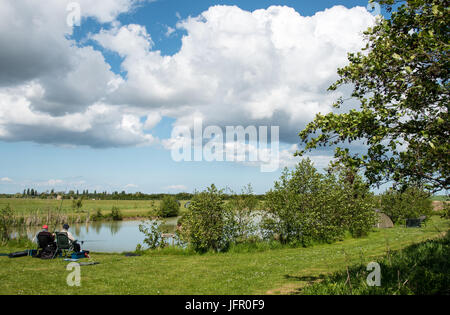 Kent, United Kingdom- 14 May 2017: Mature adult men fishing at a beautiful lake near sandwich city at Kent district, - Stock Photo