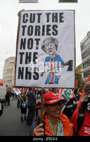 Supporters of the NHS join John McDonnell's Anti-Tory March in London. - Stock Photo