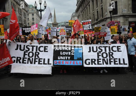 The Justice For Grenfell group join John McDonnell's Anti-Tory March in London. - Stock Photo