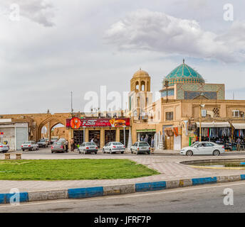 YAZD, IRAN - MAY 5, 2015: City center shops and restaurant view from the fountain on Amir Chakhmaq square in old - Stock Photo