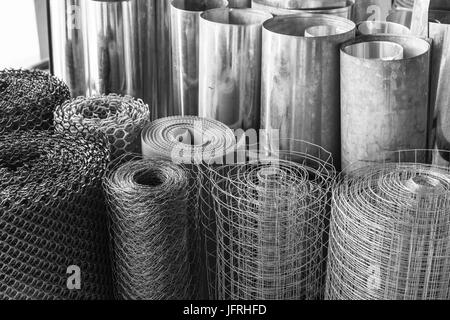 rolls of galvanized metal sheets, steel chicken wire mesh, and plastic wire mesh, meterial for making divider and - Stock Photo