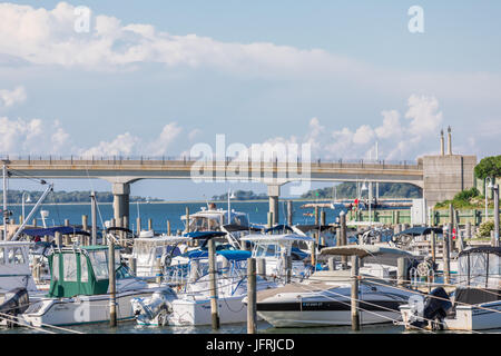 view of marina filled with boats and distant bridge in Sag Harbor, NY - Stock Photo