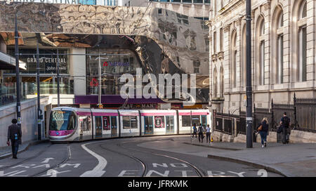 A Midland Metro Urbos 3 tram in Stephenson Street, central Birmingham, England. Grand Central, New St Station, NatWest - Stock Photo