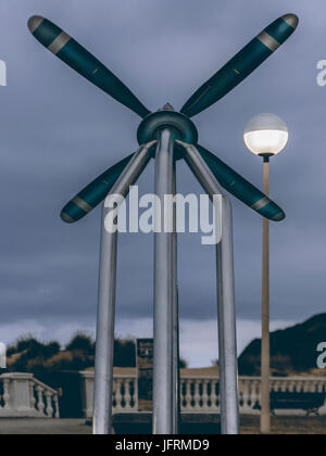 Monument to the propeller of a military aircraft on the boardwalk of Laredo, Cantabria, Spain - Stock Photo