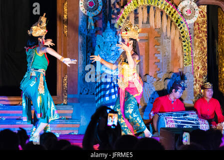 Bali, Indonesia - May 2, 2017: Spectators filming balinese dancers performing Ramayana Ballet, a traditional Hindu - Stock Photo