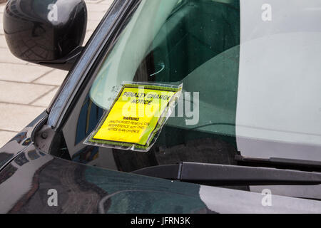 Penalty Charge Notice fixed to Windscreen - Stock Photo