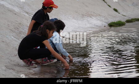 Children playng on the lake - Stock Photo