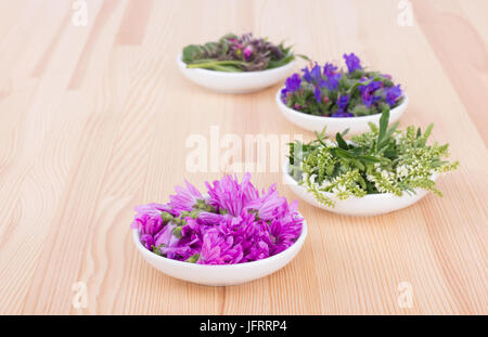 Bowls of different  edible flowers - Stock Photo