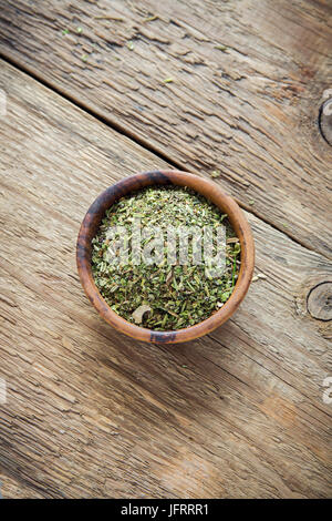 Mixed Italian Herbs Seasoning on wooden background, copy space. Dried Herbs Seasoning, healthy ingredient for cooking. - Stock Photo
