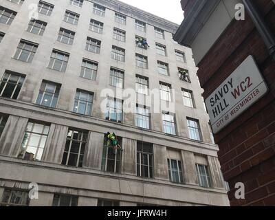 High rise window cleaners are working on a building in Central London by the Savoy Hill street in WC2. - Stock Photo
