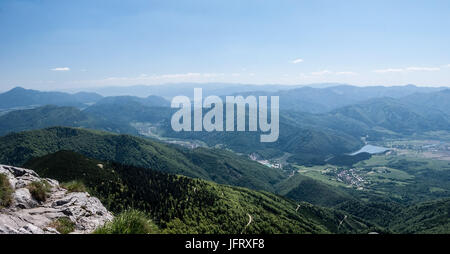 spectacular panorama from Chleb hill in Krivanska Mala Fatra mountain range in Slovakia with mountains and Vah river - Stock Photo