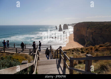 Port Campbell, Australia: October 8, 2015: Unidentified tourists sightsee the famous Twelve Apostles in Port Campbell - Stock Photo