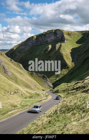 Cars on the road at Winnats Pass, Castleton, Derbyshire, England. - Stock Photo