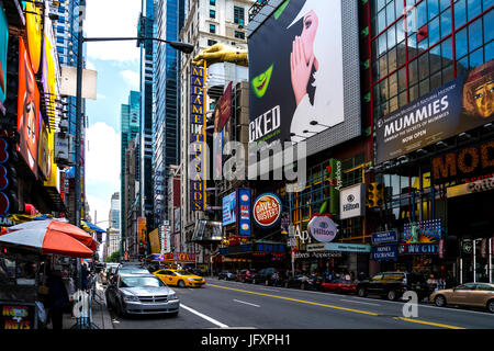 Looking up 42nd St in Time Square Manhattan New York - Stock Photo