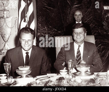 American evangelist Billy Graham and President John F. Kennedy at a prayer breakfast in Washington, D.C. at the - Stock Photo