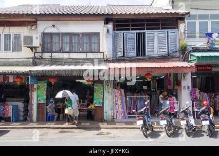 Motorbikes parked outside an old Sino Portuguese style architecture shop in Thalang Road, Phuket, Thailand - Stock Photo