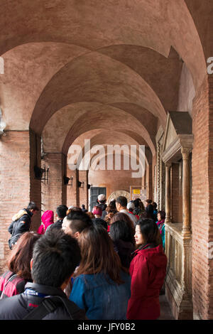 Rome, Italy - October 01, 2015. Tourists waiting to see the famous Mouth of Truth at Basilica of Santa Maria in - Stock Photo
