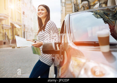 Charming woman dreaming about her next trip - Stock Photo