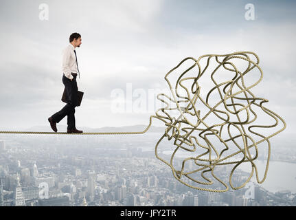 Problem and difficulty concept with tangled rope - Stock Photo