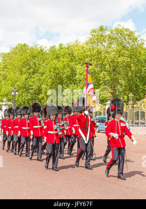 LONDON, UNITED KINGDOM – JULY 11, 2012: Soldiers of the Coldstream Guards march down The Mall at the completion - Stock Photo