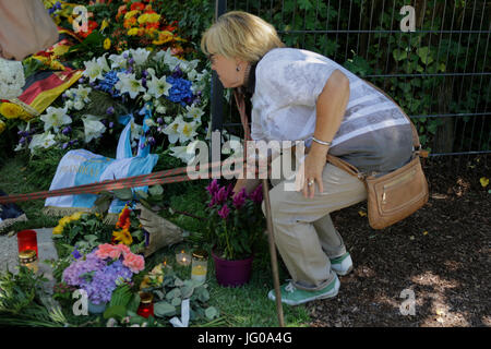 Speyer, Germany. 3rd July 2017. A woman lays down flower at the grave of Helmut Kohl. People are coming to visit - Stock Photo