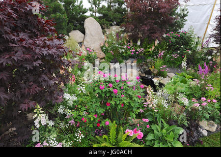 Spring flower displays in the oregon holocaust memorial in washington stock photo royalty free for Portland spring home and garden show 2017