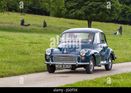Classic, collectable restored vintage vehicles being driven in woodland park, UK - Stock Photo