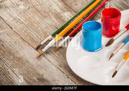 special painting tools on wooden background, education tools for schools - Stock Photo
