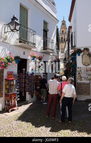 Tourists in the small square in the Calleja de las Flores, Cordoba, Spain. - Stock Photo