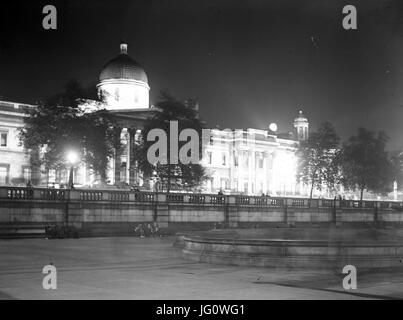 Looking across Trafalgar Square towards the National Gallery and St Martin-in-the-Fields Church in London. - Stock Photo