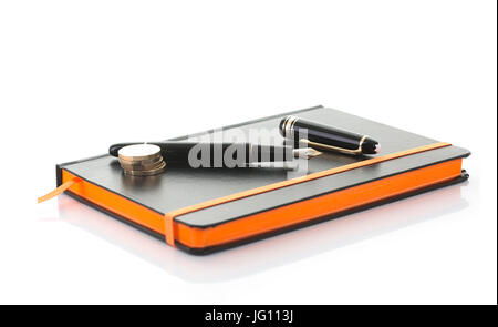 SWINDON, UK - JULY 2, 2017: Close up of a Mont Blanc fountain pen and notebook on a white background - Stock Photo