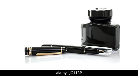 SWINDON, UK - JULY 2, 2017: Close up of a Mont Blanc fountain pen and bottle of ink on a white background - Stock Photo