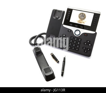 SWINDON, UK - JULY 2, 2017: Cisco IP  Video phone with new pound coins on a white background - Stock Photo
