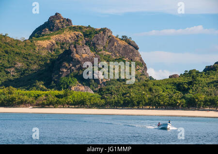 Little motorboat cruising before, Naviti island, Yasawas, Fiji, South Pacific - Stock Photo