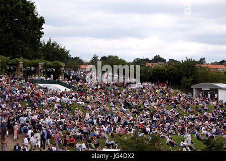 Spectators on Murray Mount on day one of the Wimbledon Championships at The All England Lawn Tennis and Croquet - Stock Photo