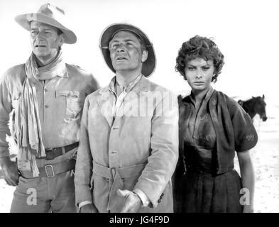 LEGEND OF THE LOST 1957 United Artists film with from left: John Wayne, Rossano Brazzi, Sophia Loren - Stock Photo