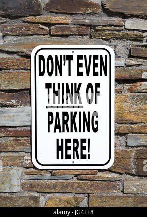 No Parking Sign with Humor - Stock Photo